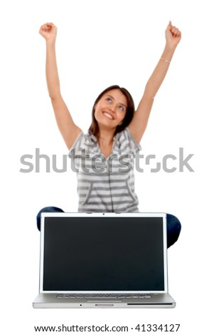 Excited woman with a laptop isolated over a white background