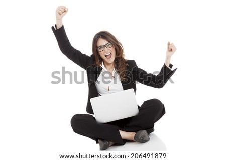Excited woman with arms up winning online - isolated over white - stock photo