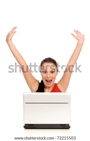 Excited woman with laptop - stock photo
