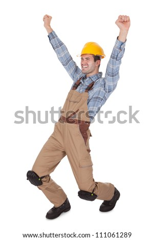 Excited worker wearing hard hat. Isolated on white - stock photo