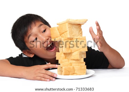 excited young boy with bread - stock photo