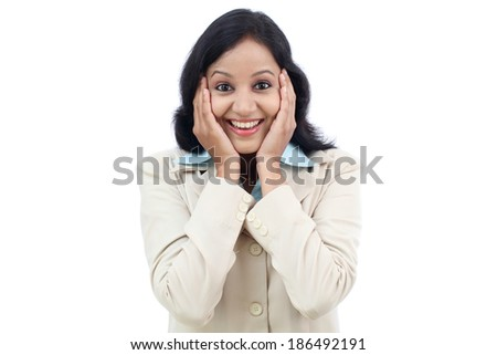 Excited young business woman against white background - stock photo
