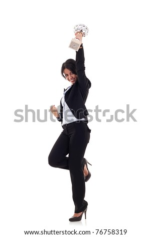 excited young business woman winning a trophy against white background - stock photo
