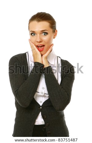 Excited young businesswoman against white background - stock photo