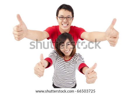 Excited young couple celebrating with thumb up - stock photo