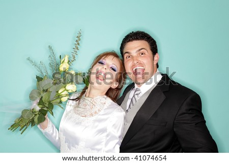 Excited young couple that just got married - stock photo