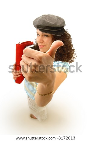 Excited young female college student giving the viewer thumbs up; focus on hand - stock photo