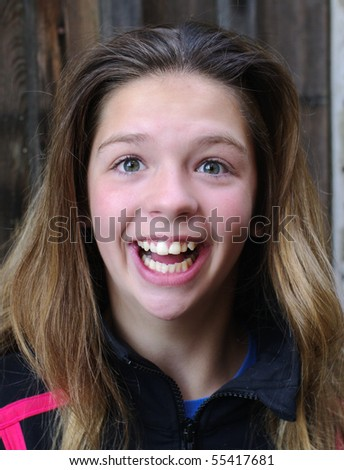Excited young girl - stock photo