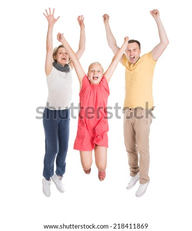 Excited Young Happy Family Jumping. Isolated On White - stock photo