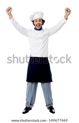 Excited young male chef over white background - stock photo