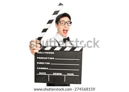 Excited young male movie director posing behind a movie clapperboard isolated on white background - stock photo