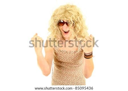 excited young man in wig and dressed as woman - stock photo