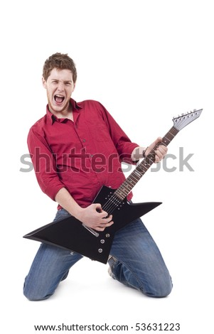 excited young man playing a guitar isolated against white background - stock photo