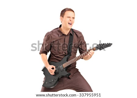 Excited young man playing on electric guitar, isolated on white background