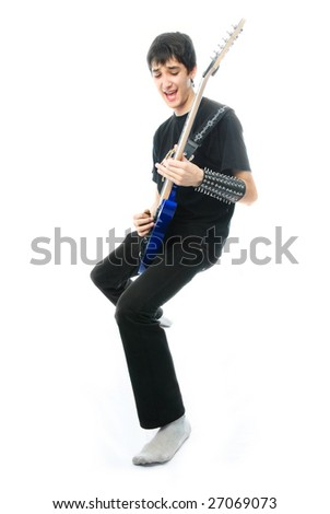 excited young man playing the guitar against white background - stock photo
