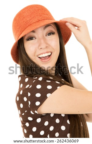 Excited young teen girl wearing orange hat - stock photo