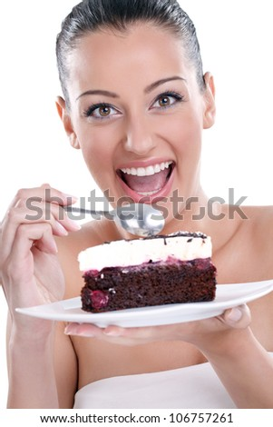 excited young woman eating tasty, chocolate cakes - stock photo