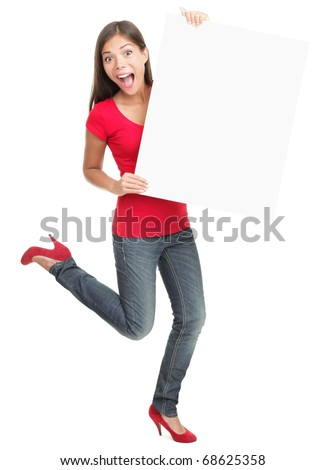 Excited young woman holding empty white board isolated on white background. - stock photo