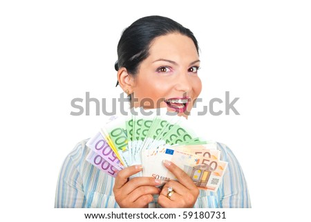 Excited young woman showing a lot of money and smiling isolated on white background - stock photo