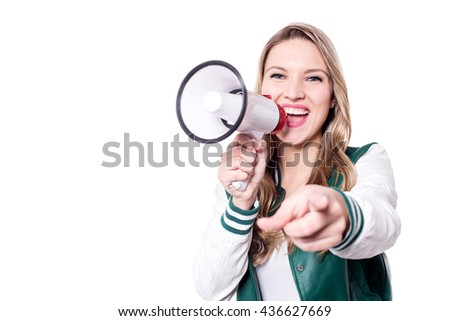 Excited young woman using loudhailer - stock photo