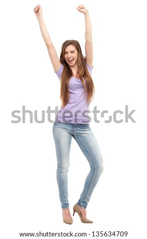 Excited young woman with arms raised