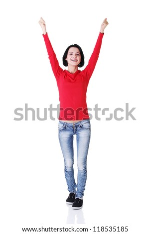Excited young woman with fists up, isolated