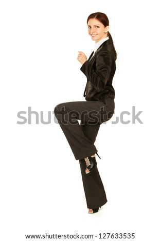 Excited young woman with fists up, isolated on white background - stock photo