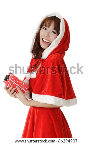 Exciting Christmas girl with smiling and enjoy face holding gift box over white. - stock photo