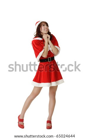 Exciting Christmas woman praying, full length portrait isolated over white. - stock photo