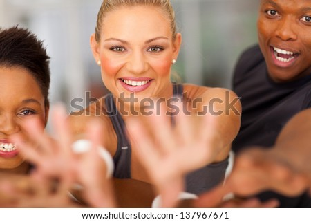 exciting fitness team reaching out - stock photo