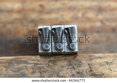 exclamation mark in letterpress type on a wooden background. - stock photo