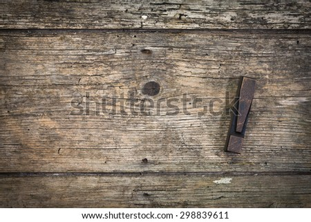 exclamation mark vintage letterpress printing block on rustic wood background, copy space at left side - stock photo