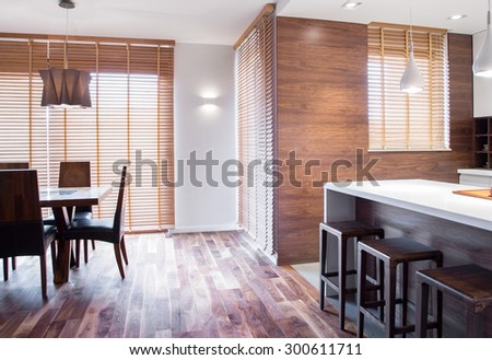 Exclusive and elegant dinning room in wooden apartment - stock photo