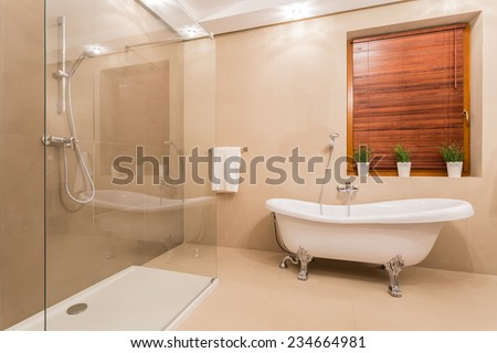 Exclusive bright bathroom with marble floor - stock photo