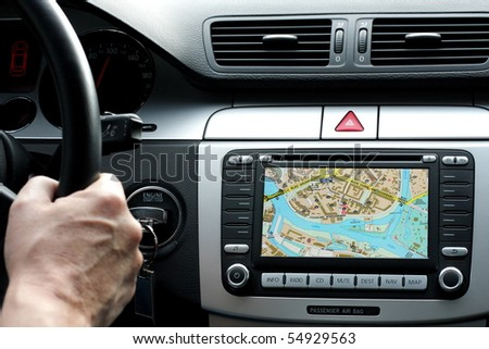 Exclusive car dashboard and gps with map of wroclaw, poland - stock photo