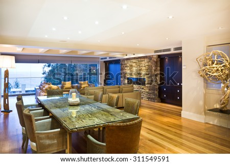 Exclusive dining room, spiced up with an elegant green-coloured wooden table - stock photo