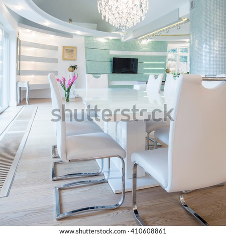 Exclusive luxury dining room with white table