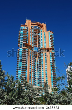 Exclusive private residences in luxury highrise on the beach - stock photo