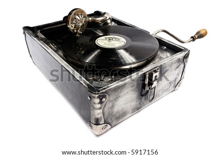 Exclusive retro gramophone in leather case. - stock photo