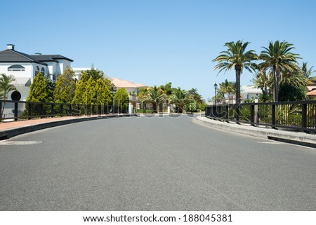 Exclusive street in modern residential subdivision. - stock photo