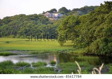 Exclusive summer home overlooking an ocean marsh - stock photo