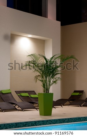 exclusive swimming pool at night - stock photo