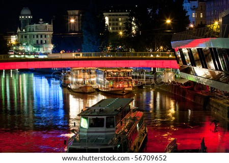 Excursion boats on danube channel are on duty also during the night - stock photo