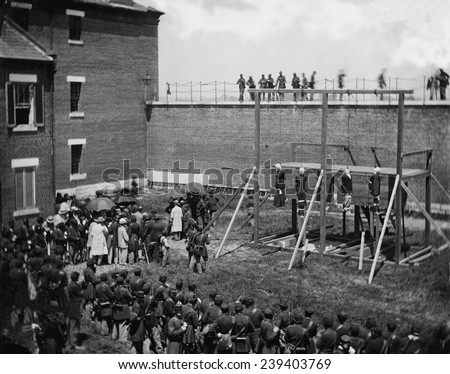 Execution of four Lincoln assassination conspirators on July 7, 1865. Hanging hooded bodies of the four conspirators: Mary E. Surratt, Lewis Payne, David E. Herold, and George Atzerodt. - stock photo