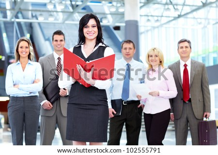 Executive business woman and a group of business person at the hall. - stock photo