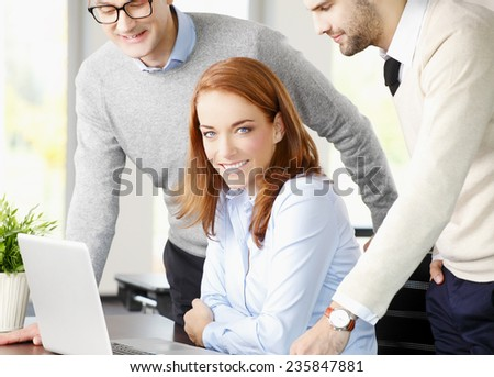 Executive business woman working with business team while working on laptop at office.  - stock photo
