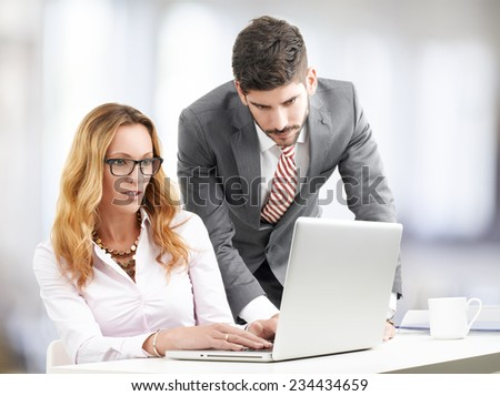 Executive bussiness woman presenting idea to sales man. Teamwork at office. - stock photo