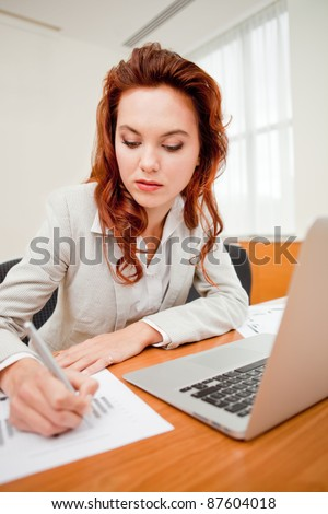Executive female worker at the office with a laptop computer