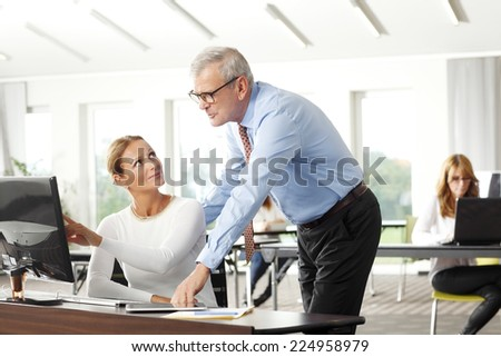 Executive financial advisor working together with business woman at office.  - stock photo