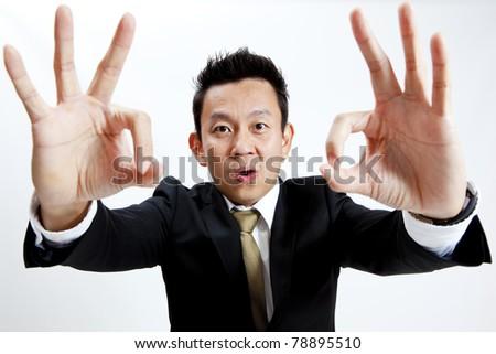 executive giving okay sign - stock photo